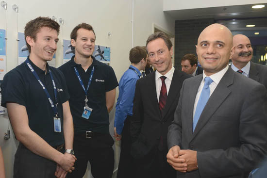 Sajid Javid MP, right, accompanied by Airbus CEO Fabrice Bregier, meets graduates Nicholas Rogers and Oliver McCambridge.
