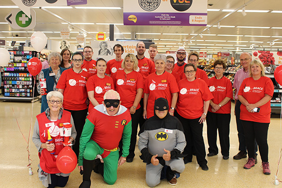 Superheroes help charity link with store